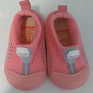 Baby's pink water shoes.
